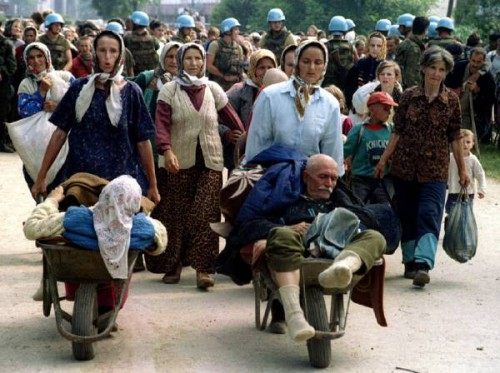 Group of Bosnian Moslems, refugees from Srebrenica, walk to be transported near Potocari